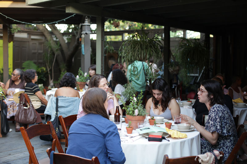 Guests were seated in the enclosed garden