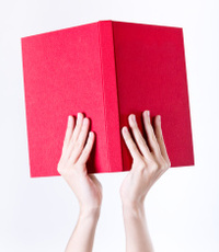 33689406-woman-hands-holding-a-red-book